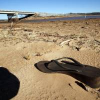 Photo - An abandoned shoe sets well above the water line at Lake Thunderbird. PHOTO BY STEVE SISNEY, THE OKLAHOMAN  STEVE SISNEY