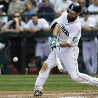 Photo - Seattle Mariners' Dustin Ackley hits a three-run home run in the fifth inning of a baseball game against the Washington Nationals, Sunday, Aug. 31, 2014, in Seattle. (AP Photo/Ted S. Warren)