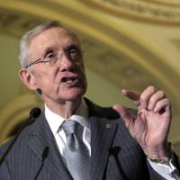Photo - Senate Majority Leader Harry Reid of Nevada speaks to reporters following the Democratic policy luncheon on Capitol Hill in Washington, Tuesday, Dec. 18, 2012. (AP Photo/Susan Walsh)