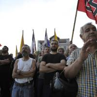 Photo -   FILE - In this June 10, 2012, file photo, supporters of the extreme right-wing Golden Dawn party, attend a pre-election rally at the northern port city of Thessaloniki Greece. Bankers, governments and investors are starting to prepare for Greece to drop the euro currency, a move that could spread turmoil throughout the global financial system. A Greek election on Sunday, June 12, 2012, will go a long way toward determining whether it happens. (AP Photo/Nicolas Giakoumidis, File)