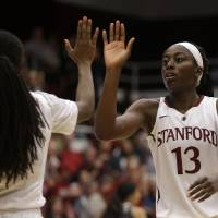 Photo - Stanford's Chiney Ogwumike, right, celebrates with Lili Thompson during the second half of an NCAA college basketball game against Washington State Saturday, March 1, 2014, in Stanford, Calif. (AP Photo/Ben Margot)