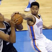Photo - Oklahoma City's Jeremy Lamb (11) defends against San Antonio's Boris Diaw (33) during Game 2 of the Western Conference semifinals in the NBA playoffs between the Oklahoma City Thunder and the Los Angeles Clippers at Chesapeake Energy Arena in Oklahoma City, Monday, May 7, 2014. Photo by Bryan Terry, The Oklahoman