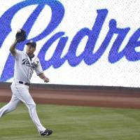 Photo - San Diego Padres right fielder Seth Smith runs down a line drive in the right field corner to take a hit away from Cincinnati Reds' Brandon Phillips in the second inning of a baseball game Monday, June 30, 2014, in San Diego.  (AP Photo/Lenny Ignelzi)