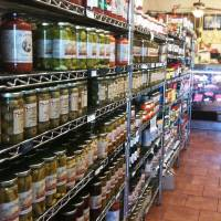 Photo - Aisles at Lovera's Italian Market are stocked with house-made products and imports from Italy.  Dave Cathey - The Oklahoman
