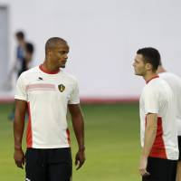 Photo - Belgium's captain Vincent Kompany, left, and Thomas Vermaelen, who are both recovering from injury, take part in a training session at Estadio Manoel Barradas, the day before the World Cup round of 16 soccer match between Belgium and USA at Arena Fonte Nova in Salvador, Brazil, Monday, June 30, 2014. (AP Photo/Matt Dunham)