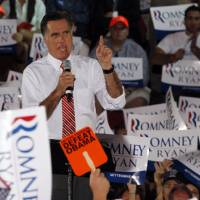 Photo -   Republican presidential candidate Mitt Romney, gestures during a rally in Fishersville, Va., Thursday, Oct. 4, 2012.(AP Photo/Steve Helber)