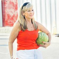 Photo - Sandy Price, Oklahoma City, buys a watermelon at the Farmer's Market at the Cleveland County Fairgrounds on Saturday, July 16, 2011, in Norman, Okla.   Photo by Steve Sisney, The Oklahoman ORG XMIT: KOD