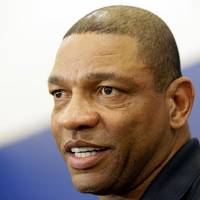 Photo - Los Angeles Clippers coach Doc Rivers comments on Jamal Crawford winning the 2013-14 NBA Sixth Man of the Year, at the Los Angeles Clippers Training Center in Los Angeles Thursday, May 8, 2014.Crawford, the 34-year-old guard also was honored as the league's best player off the bench while with the Atlanta Hawks in 2009-10. (AP Photo/Damian Dovarganes)