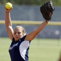 Photo - Edmond North's Jordan Dixon pitches against Grove during a high school softball game at ASA Hall of Fame Stadium in Oklahoma City, Saturday, August 27, 2011. Photo by Bryan Terry, The Oklahoman