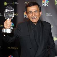 Photo - FILE - In this Oct. 27, 2003 file photo, Casey Kasem poses for photographers after receiving the Radio Icon award during The 2003 Radio Music Awards at the Aladdin Resort and Casino in Las Vegas. Kasem, the smooth-voiced radio broadcaster who became the king of the top 40 countdown, died Sunday, June 15, 2014, according to Danny Deraney, publicist for Kasem's daughter, Kerri. He was 82. (AP Photo/Eric Jamison, file)