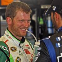 Photo -   Driver Dale Earnhardt, Jr., left, shares a laugh with fellow driver Jimmie Johnson, right, in the garage before a practice session, Friday morning, June 29, 2012, for Saturday night's NASCAR Sprint Cup Series auto race at Kentucky Speedway in Sparta, Ky. (AP Photo/Bud Kraft)