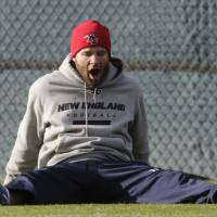 Photo -   New England Patriots wide receiver Julian Edelman yawns as he stretches prior to NFL football practice in Foxborough, Mass., Tuesday, Nov. 20, 2012. (AP Photo/Charles Krupa)