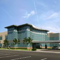Photo - This drawing shows a $20 million building to house an ambulatory surgery center and inmaging center as part of Healthcare Partners Investments LLC's project to build a medical center near the Broadway Extension and Britton Road.   - PROVIDED BY HPI LLC