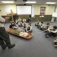 Photo - Scouts listen to Scout Master Ron Butts give a search and rescue training lesson during a meeting at St. Mary's Episcopal Church. Photo By David McDaniel, The Oklahoman