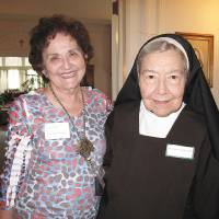 Photo - Linda Anne Huffman Zablatnik of Oklahoma City poses for a picture with Sister Elizabeth Ann Koberstein during the recent Carmelite Sisters of St. Therese's 95th anniversary and alumni gathering at Villa Teresa Convent and School in Oklahoma City. Photo by Carla Hinton, The Oklahoman