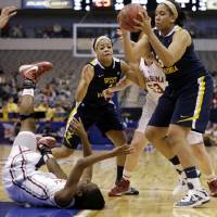 Photo - Oklahoma's Sharane Campbell, bottom left, loses control of the ball after falling to the court as West Virginia' Ayana Dunning, top right, gains control in the first half of an NCAA college basketball game in the Big 12 women's tournament Saturday, March 9, 2013, in Dallas. Wester Virginia' Christal Caldwell (1)  and Oklahoma' Joanna McFarland (53) watch during the play. (AP Photo/Tony Gutierrez)