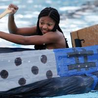 Photo -  Cara Hutchings, a high school sophomore from Longview, Texas, paddles her self-designed boat in the cardboard regatta as part of the University of Oklahoma's summer engineering camp. PHOTO BY STEVE SISNEY, THE OKLAHOMAN   STEVE SISNEY -