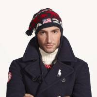 Photo - This undated product image provided by Ralph Lauren shows U.S. Olympic skater Evan Lysacek wearing fashion by designer Ralph Lauren for the 2014 Winter Olympics. Every article of clothing made by Ralph Lauren for the U.S. Olympic athletes in Sochi has been made by domestic craftsman and manufacturers. (AP Photo/Ralph Lauren)