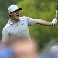 Photo - Rory McIlroy, of Northern Ireland, watches his tee shot on the 12th hole during the second round of the PGA Championship golf tournament at Valhalla Golf Club on Friday, Aug. 8, 2014, in Louisville, Ky. (AP Photo/David J. Phillip)