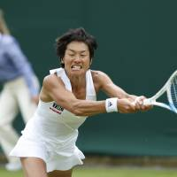 Photo - Japan's Kimiko Date-Krumm plays a return to Russia's Ekaterina Makarova during their first round match at the All England Lawn Tennis Championships in Wimbledon, London,  Monday, June  23, 2014. (AP Photo/Ben Curtis)
