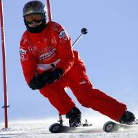 Photo - FILE - In this Friday, Jan. 13, 2006 file photo, Ferrari driver Michael Schumacher of Germany speeds down a course in Madonna di Campiglio, Italy. Schumacher is in this Italian Alps ski resort for the yearly meeting between Ferrari drivers and the press.  French radio says retired Formula One champion Michael Schumacher has been injured in a skiing accident.  RMC radio reported Sunday Dec. 29, 2013 that the seven-time champion had fallen while skiing off-piste at the French Alpine resort of Meribel.  The radio quoted resort director Christophe Gernigon-Lecomte as saying that Schumacher was wearing a helmet when he fell and hit a rock. (AP Photo/Luca Bruno, File)