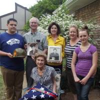 Photo -  Four generations of Raymond Scoufos' family pose for a photo, holding memoriabilia of the late patriarch's service in WWII. From left, Jared Lunch, Vince Scoufos, Billie Scoufos (center), Ramona Harbour, Lezley Lynch and Alyson Lynch. Photo by Heather Warlick, The Oklahoman.
