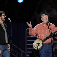 Photo - FILE - In this May 3, 2009 file photo, musician Pete Seeger, right, and grandson Tao Rodríguez-Seeger perform at a benefit concert celebrating Seeger's 90th birthday at Madison Square Garden in New York. A five-day festival honoring the late folk singer will feature music, film and remembrances in New York City and the Hudson Valley. Seeger grandson Kitama Cahill-Jackson says Wednesday, April 30, 2014, the free