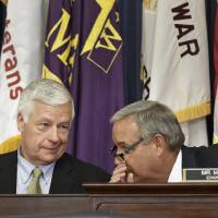Photo - Rep. Jeff Miller, R-Fla., right, chairman of the House Committee on Veterans' Affairs, confers with Rep. Mike Michaud, D-Maine, the ranking member, left, as the panel holds a hearing to examine why thousands of military veterans have been waiting for up to three months for medical appointments, on Capitol Hill in Washington, Monday, June 9, 2014.  (AP Photo/J. Scott Applewhite)