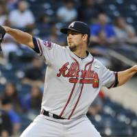 Photo - Atlanta Braves starter Mike Minor pitches against the New York Mets in the first inning of a baseball game at Citi Field on Thursday, Aug. 28, 2014, in New York. (AP Photo/Kathy Kmonicek)