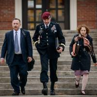 Photo - FILE - In this March 4, 2014 file photo, Brig. Gen. Jeffrey Sinclair leaves the courthouse with his lawyers Richard Scheff, left, and Ellen C. Brotman, following a day of motions at Fort Bragg, N.C. Less than a month before Sinclair's trial on sexual assault charges, the lead prosecutor broke down in tears Tuesday as he told a superior he believed the primary accuser in the case had lied under oath. (AP Photo/The Fayetteville Observer, James Robinson)  MANDATORY CREDIT