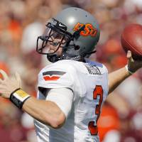 Photo - OKLAHOMA STATE UNIVERSITY: OSU's Brandon Weeden (3) passes during a college football game between the Oklahoma State Cowboys and the Texas A&M Aggies at Kyle Field in College Station, Texas, Saturday, Sept. 24, 2011. Photo by Nate Billings, The Oklahoman  ORG XMIT: KOD