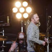 Photo -  Caleb Followill, right, and Nathan Followill from the band Kings of Leon perform at the 3rd annual Governors Ball Music Festival on Saturday, June 8, 2013 in New York. (AP)
