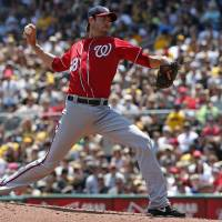 Photo - Washington Nationals starting pitcher Doug Fister delivers during the first inning of a baseball game against the Pittsburgh Pirates in Pittsburgh, Sunday, May 25, 2014. (AP Photo/Gene J. Puskar)