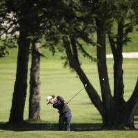 Photo - Lydia Ko, of New Zealand, hits an approach shot to the fifth green of Lake Merced Golf Club during the final round of the Swinging Skirts LPGA Classic golf tournament on Sunday, April 27, 2014, in Daly City, Calif. (AP Photo/Eric Risberg)