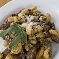 Photo - In this image taken on Feb. 27, 2012, a 15-minute seared bison with sage and gnocchi is shown in Concord, N.H. (AP Photo/Matthew Mead)
