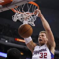 Photo -   Los Angeles Clippers forward Blake Griffin, right, dunks as Oklahoma City Thunder guard Reggie Jackson looks on during the first half of an NBA basketball game in Los Angeles, Monday, Jan. 30, 2012. (AP Photo/Chris Carlson)