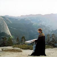 Photo - Composer Chance Thomas gets in the spirit of J.R.R. Tolkien's fantasy world in this provided photo. Thomas, seen wearing robes and playing a keyboard, has written scores for 10 computer and video games based on Tolkien's work.   - Provided