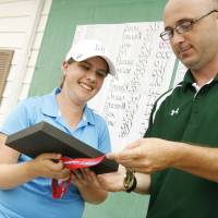 Photo - Edmond North's Allison Sell receives her trophy as the best individual player from Tournamnet Manager Kevin Hogue at the Class 6A Girls State Golf tournamnet at Muskogee Country Club in Muskogee, Okla. taken on May 3, 2012. JAMES GIBBARD/Tulsa World