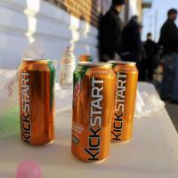 Photo - Product cans are on display during the filming of a commercial for a new PepsiCo product called Kickstart, a carbonated drink that is part juice with Mountain Dew flavor, on the streets of downtown Los Angeles Tuesday, Jan. 29, 2013.  PepsiCo Inc. is set to roll out the new drink called Kickstart this month that has Mountain Dew flavor but is made with 5 percent juice and an extra jolt of caffeine and Vitamins B and C. The company is hoping to grow sales by reaching Mountain Dew fans at a new time of day: morning.  (AP Photo/Reed Saxon)