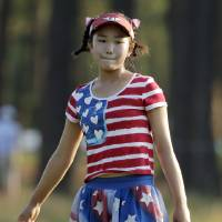 Photo - Lucy Li reacts to her putt on the 11th hole during the first round of the U.S. Women's Open golf tournament in Pinehurst, N.C., Thursday, June 19, 2014. (AP Photo/Chuck Burton)