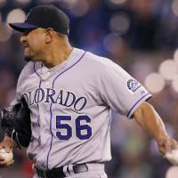 Photo - Colorado Rockies starting pitcher Franklin Morales throws down the rosin bag after giving up a two-run home run during the fourth inning of a baseball game against the Kansas City Royals at Kauffman Stadium in Kansas City, Mo., Tuesday, May 13, 2014. (AP Photo/Orlin Wagner)