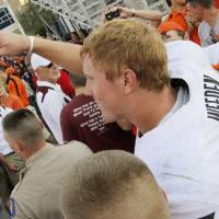 Photo - Oklahoma State 's Brandon Weeden (3) points to fans after a college football game between the Oklahoma State Cowboys and the Texas A&M Aggies at Kyle Field in College Station, Texas, Saturday, Sept. 24, 2011. OSU won, 30-29. Photo by Nate Billings, The Oklahoman  ORG XMIT: KOD