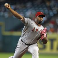 Photo - Los Angeles Angels starter Jerome Williams delivers a pitch in the first inning of a baseball game against the Houston Astros Sunday, Sept. 15, 2013, at Minute Maid Park in Houston. (AP Photo/Eric Christian Smith)