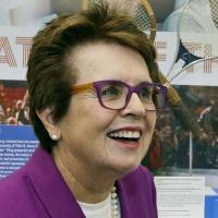 Photo - FILE - In this Sept. 5, 2013, file photo, Billie Jean King reflects about her match against Bobby Riggs in 1973 as she stands in front of a display at the U.S. Open tennis tournament in New York. King watched the gold-medal hockey game won by Canada, greeted U.S. athletes and met with a Russian gay teenager in her whirlwind three days at the Sochi Olympics. She'd like the IOC to add sexual orientation to its charter and consider the issue when deciding host countries for future Olympics. (AP Photo/Darron Cummings, File)