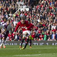 Photo - Manchester United's Wayne Rooney scores a penalty against Aston Villa, during their English Premier League soccer match at Old Trafford Stadium, Manchester, England, Saturday March 29, 2014. (AP Photo/Jon Super)