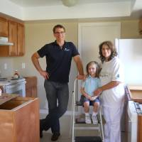 Photo - Linda Lipofsky, of Orlando, stands in her kitchen with grandson David Lipofsky, 4, and Tim Parsons of Rebuilding Together. Photo provided