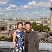Photo - Actors Emily Blunt and Tom Cruise at a photocall for their new film Edge of Tomorrow, where a part is being filmed in Trafalgar Square, background,  in London, Sunday, May 25, 2014.  Nelson's Column is at right, the National Gallery is at left,  (AP Photo / John Stillwell/PA) UNITED KINGDOM OUT