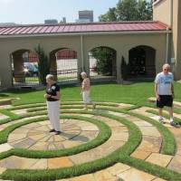 Photo - St. Paul's Episcopal Cathedral members Joyce Gibb and Kathy and Malcolm May walk the labyrinth in the east garden of the downtown Oklahoma City church, 127 NW 7. PHOTO BY CARLA HINTON, THE OKLAHOMAN  Carla Hinton - The Oklahoman