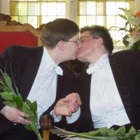 Photo - FILE - In this Aug. 1, 2001 file picture German lesbian couple Gudrun Pannier, left, and Angelika Baldow, right, kiss each other in the Rathaus Schoeneberg, city hall, in Berlin . Pannier and Baldow were the first gay couple in Berlin who exchanged vows at a partnership ceremony to receive some of the same rights as heterosexual marriages under a new law that went into effect on Aug. 1, 2001.  Gay rights campaigners won a victory in Germany on Thursday June 6, 2013 when the country's top court ordered the government to grant homosexual civil unions the same tax benefits as heterosexual married couples. The Federal Constitutional Court in Karlsruhe ruled that treating the two forms of partnership differently for tax purposes violates the country's guarantee of equal rights. (AP Photo/Markus Schreiber, File )