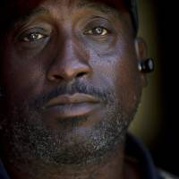 Photo -   In this Sept. 19, 2012 picture, homeless veteran Jerome Belton poses for a portrait at a homeless shelter in San Diego. A former Marine, Belton now lives on the streets in San Diego. Despite budget increases and an aggressive strategy, the Obama administration struggles to make good on its audacious promise: End homelessness among veterans by 2015. (AP Photo/Gregory Bull)